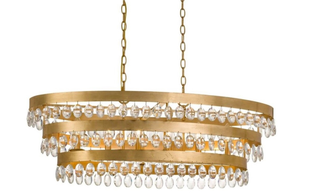 Large gold and crystal modern chandelier on white background.