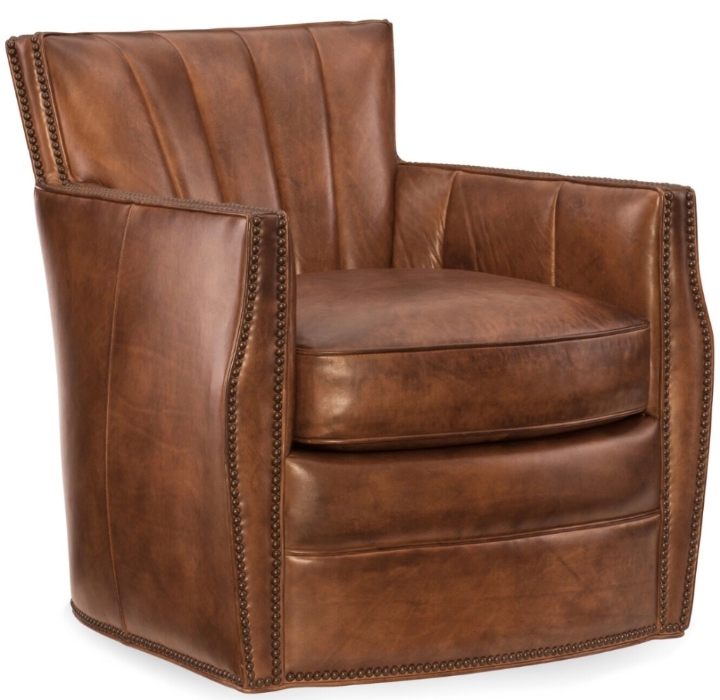 Brown leather chair on white backdrop.